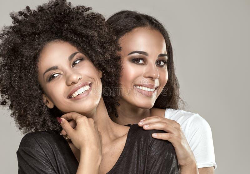 Smiling beautiful african american girls. stock photos