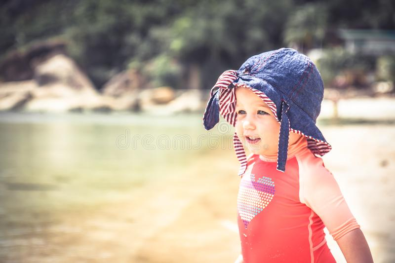 Smiling beautiful baby child kid leisure activity fun beach sea during hot summer holidays royalty free stock photography
