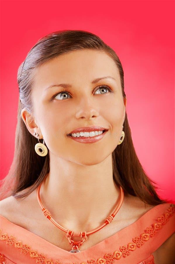 Smiling beautiful brunette woman stock image