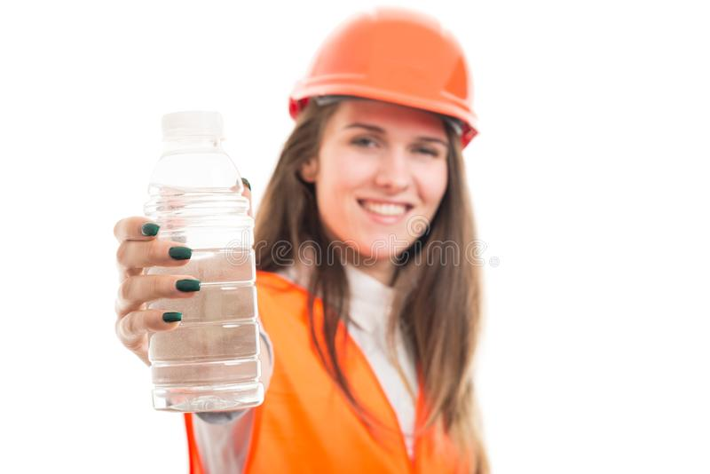 Smiling beautiful woman giving bottle of water royalty free stock images