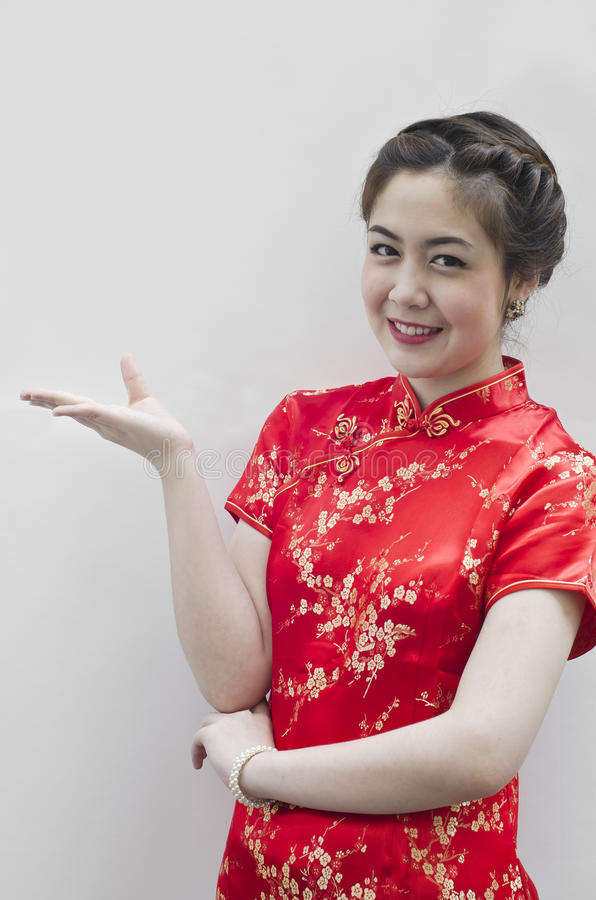 Smiling beautiful chinese young woman gesturing stock image