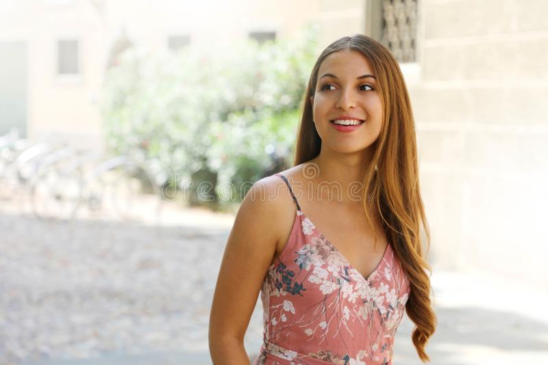 Smiling beautiful elegant young woman walking in old Italian town looking to the side stock photos