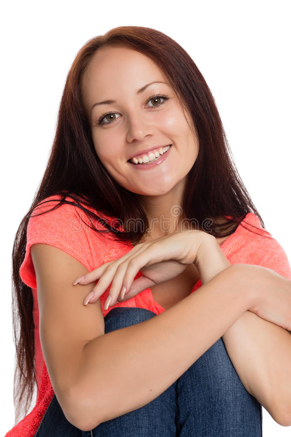 Smiling beautiful girl sitting on the floor royalty free stock photos