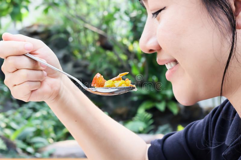 Smiling beautiful long black hair Asian women eating, hand catch stock images