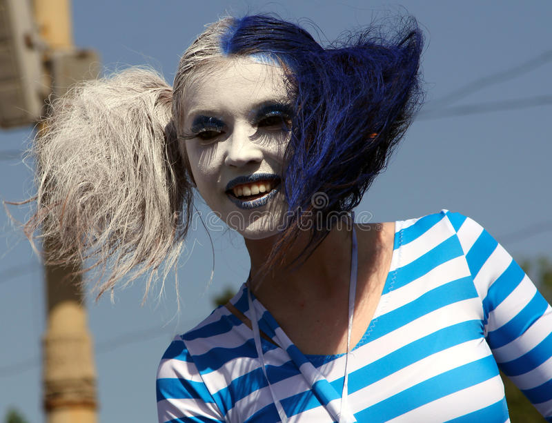 Smiling beautiful mime artist at Cosplay festival stock images