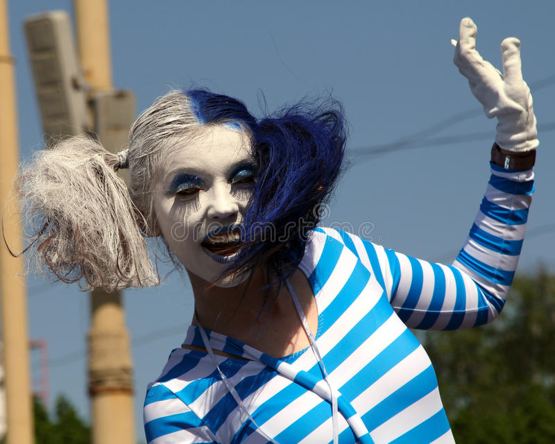 Smiling beautiful mime artist at Cosplay festival royalty free stock images