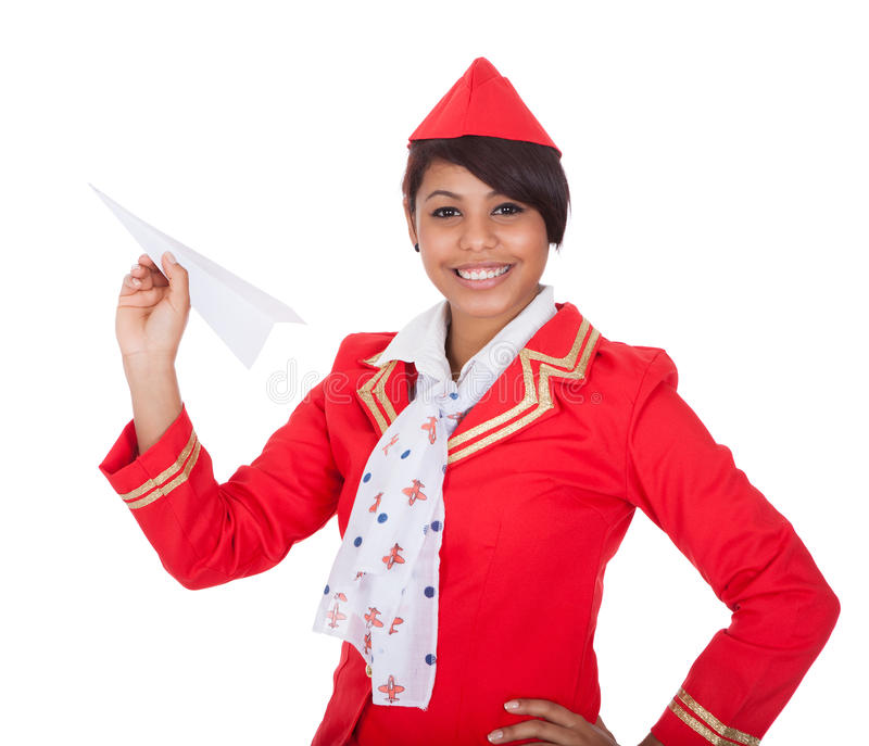Smiling beautiful stewardess launching a place royalty free stock photography