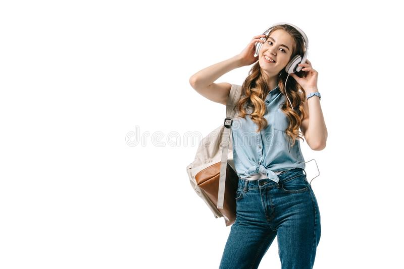 smiling beautiful student listening to music with headphones stock photos