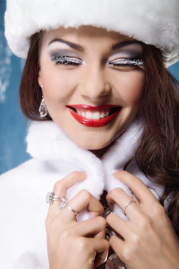 Smiling beautiful winter woman stock photos