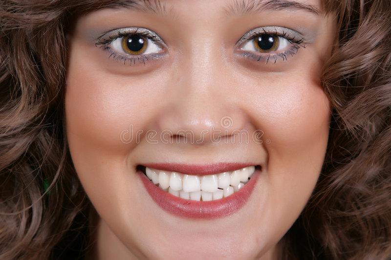 Smiling beautiful woman. A smiling beautiful woman with a white teeth royalty free stock images