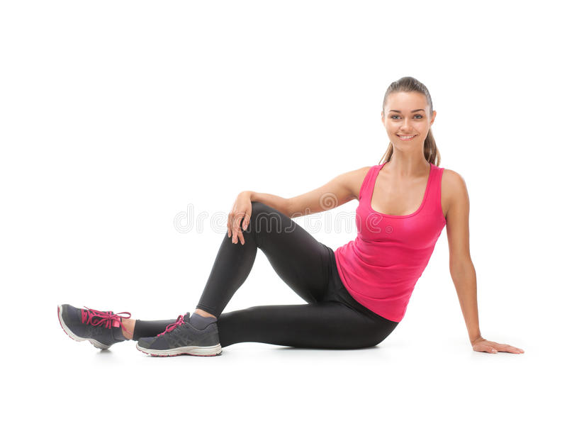 Smiling beautiful woman doing exercise stock photography