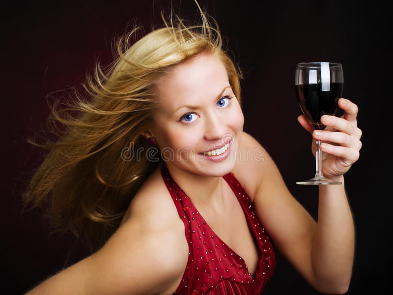 Smiling beautiful woman holding wine stock photography