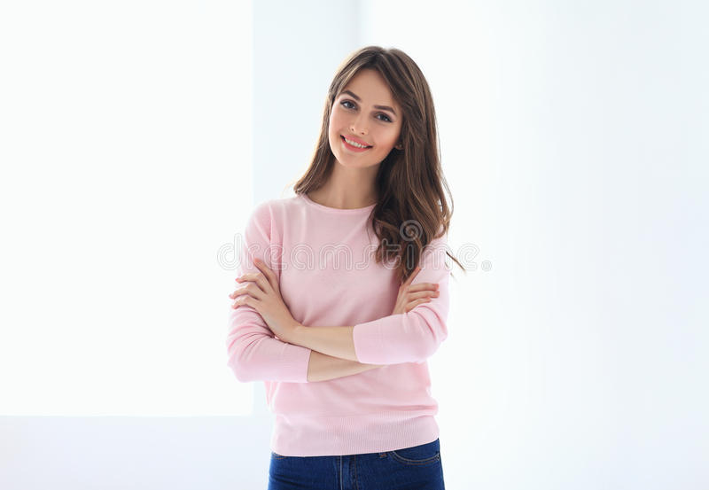 Smiling beautiful woman portrait with crossed arms. On white background royalty free stock photo