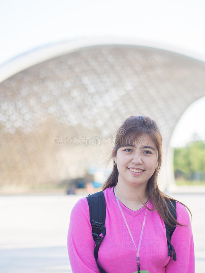 Smiling Beautiful Young Asian - Chinese Woman Traveling to Garden by The Bay, Singapore stock photo