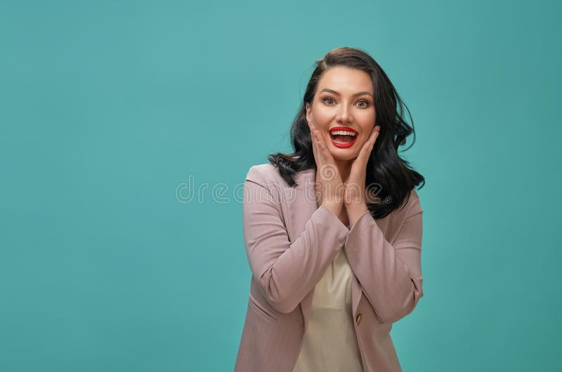 Woman on teal background stock photography