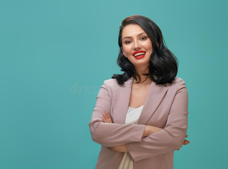 Woman on teal background stock photos