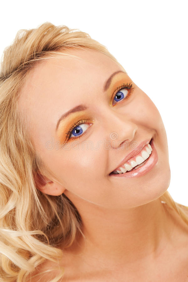Smiling beauty. Happy smiling blond girl with blue eyes royalty free stock photo