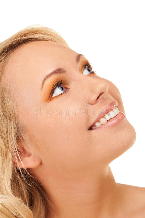 Smiling beauty. Happy smiling blond girl with blue eyes royalty free stock photos