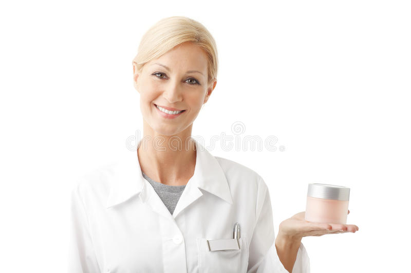 Smiling beauty therapist stock photography