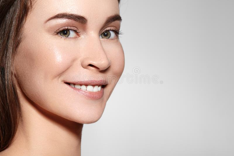 Smiling Beauty Woman Face Portrait. Beautiful Spa Model Girl with Perfect Fresh Clean Skin. Youth and Skin Care Concept stock photos