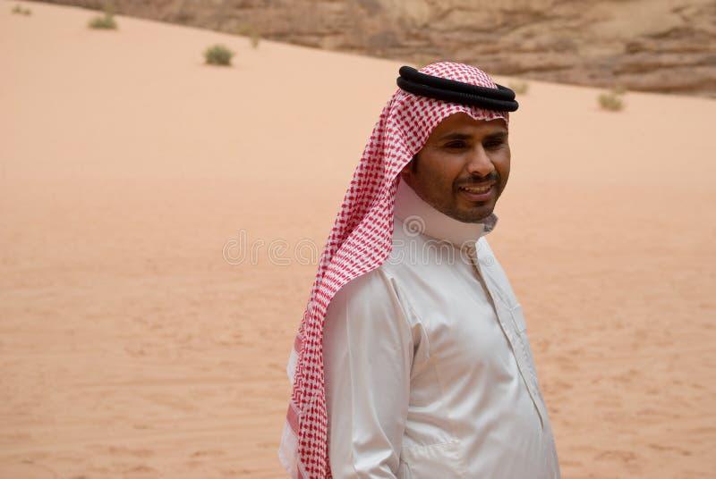 Smiling Bedouin man, portrait. Wadi Rum desert, Bedouin man posing at camera, portrait royalty free stock image