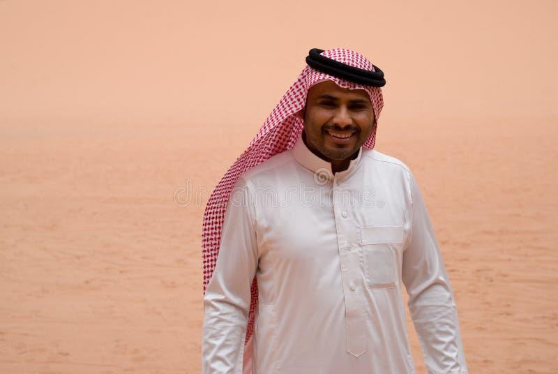 Smiling Bedouin man, portrait. Wadi Rum desert, Bedouin man posing at camera, portrait stock image