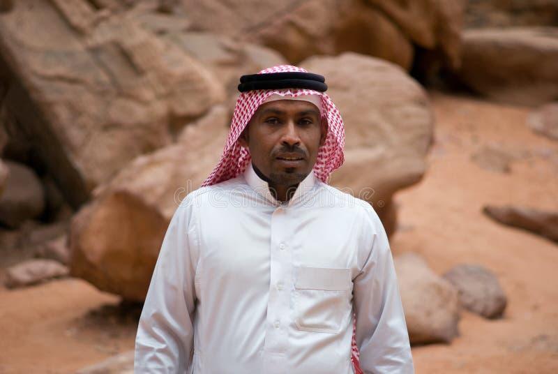 Smiling Bedouin man, portrait. Wadi Rum desert, Bedouin man posing at camera, portrait royalty free stock photography