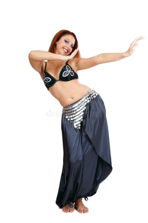 Smiling bellydancer. Pretty smiling bellydancer in costume dancing gracefully stock photos