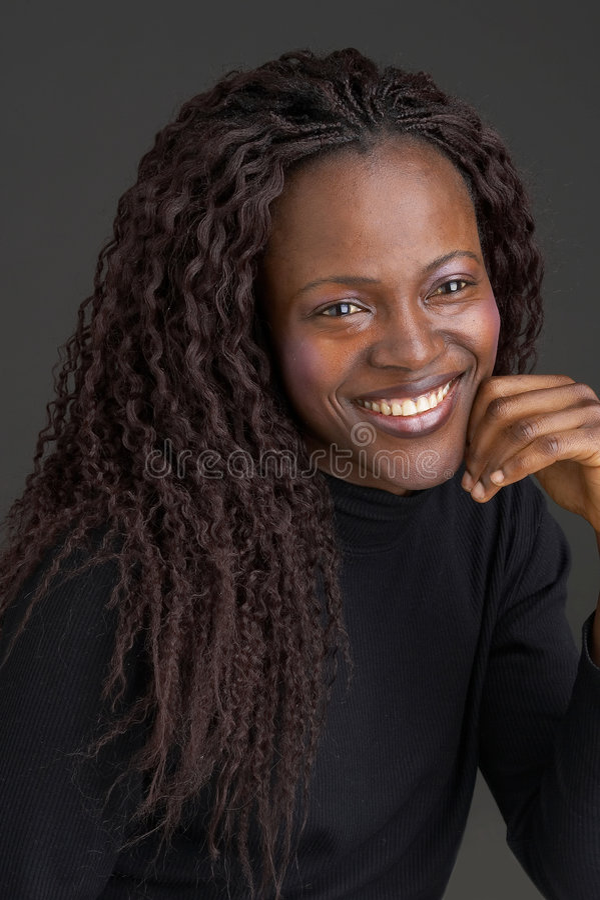 Smiling black girl stock images
