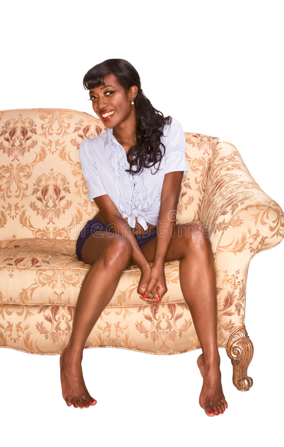 Smiling black girl on coach retro style portrait royalty free stock photography