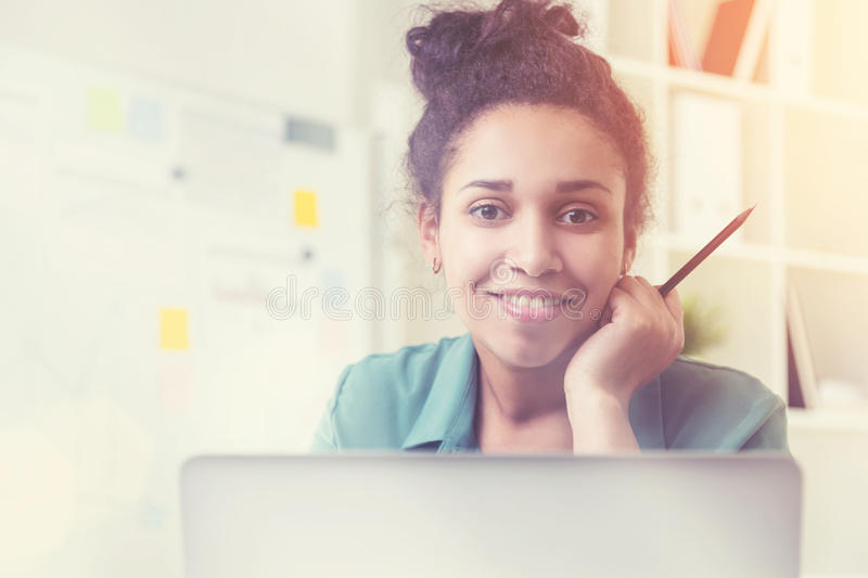 Smiling black girl portrait in room stock photography