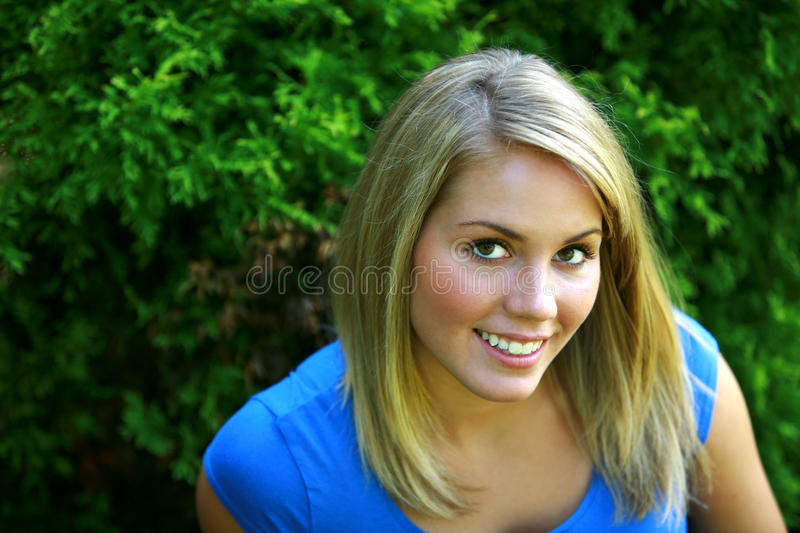 Smiling blond girl royalty free stock photo
