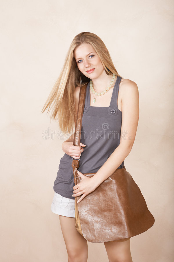 Download Smiling blond girl stock photo. Image of pockets, funky - 4956866