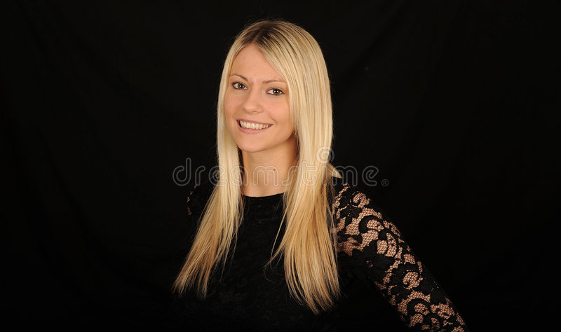 Smiling blond haired woman royalty free stock image