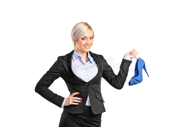 Download Smiling Blond Holding A Shoe Stock Photo - Image of looking, beautiful: 19602854