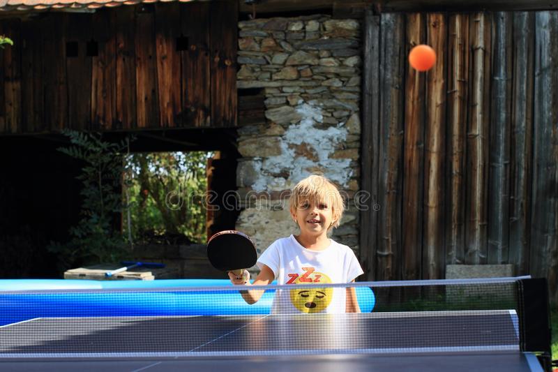 Little girl playing ping-pong stock images