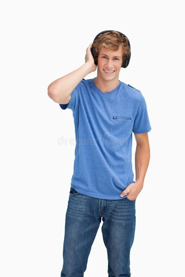 Smiling Blond Man Wearing Headphones Stock Photos