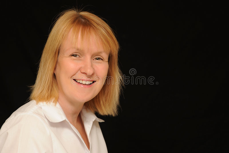 Smiling blond woman royalty free stock photos