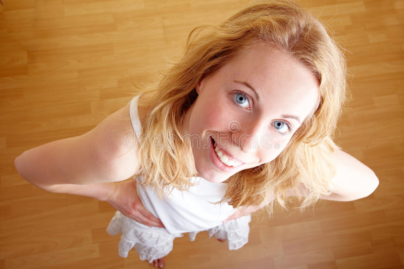 Smiling blonde. Full body shot of a blond woman looking up royalty free stock image