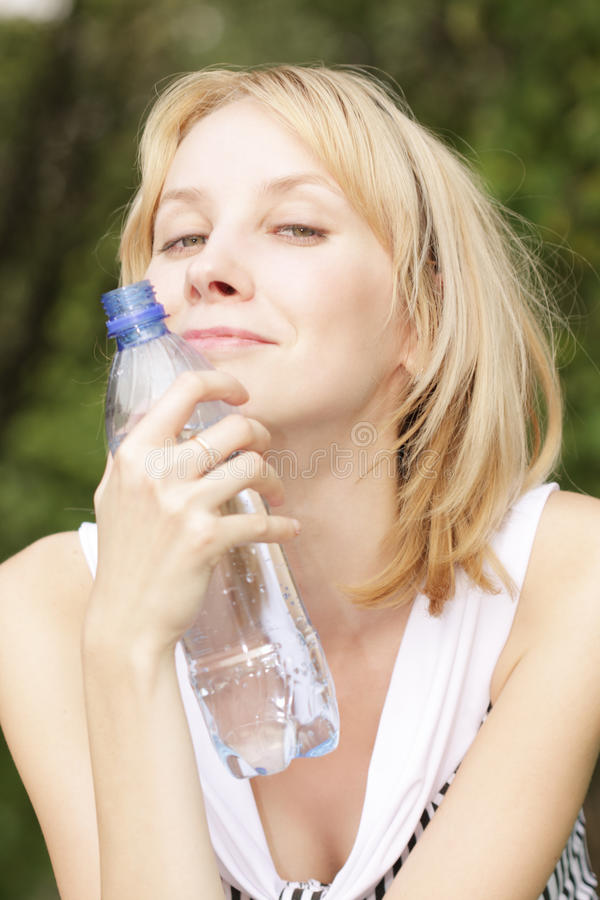 Smiling Blonde With Bottle Of Water Royalty Free Stock Photos