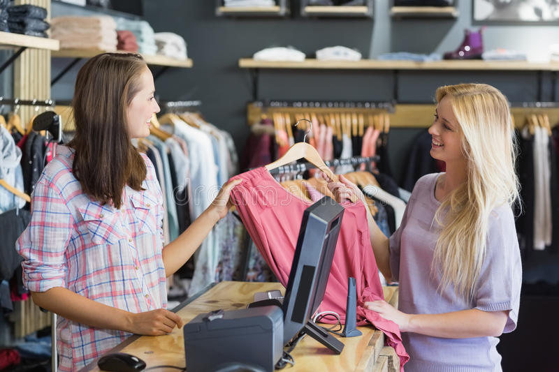 Smiling blonde doing shopping royalty free stock images