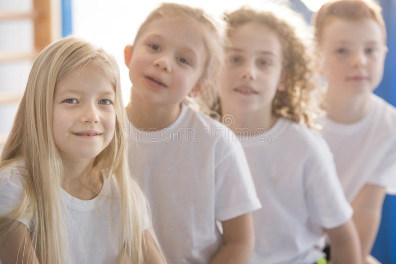 Smiling blonde girl with friends stock photography