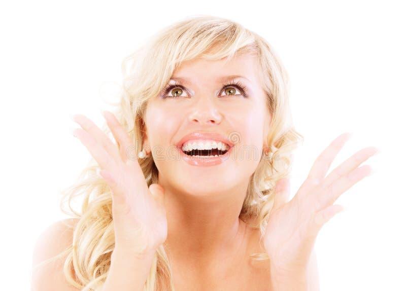 Smiling blonde in joyful admiration. Isolated on white background stock image
