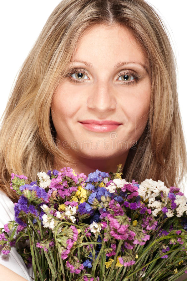 Smiling blonde woman with bouquet stock images