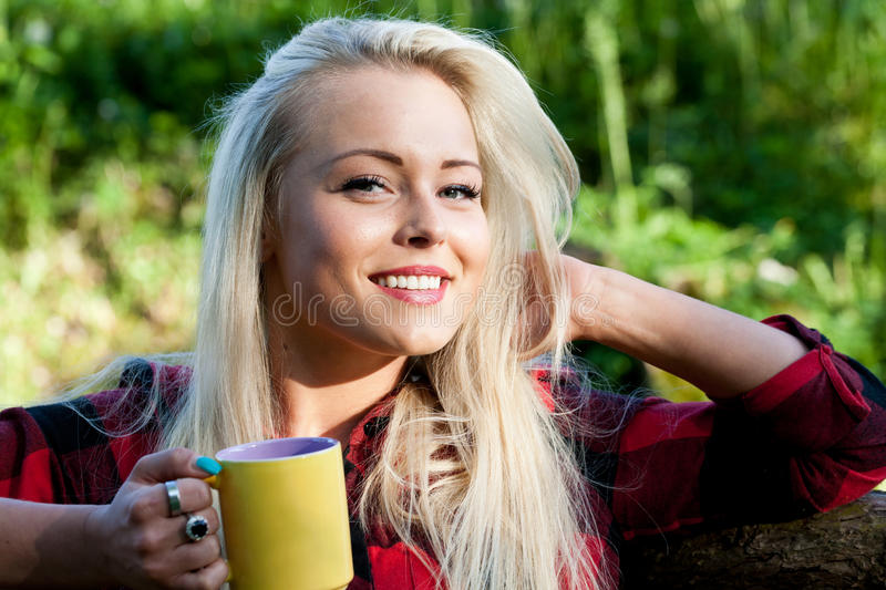 Smiling blonde woman in the countryside stock photography