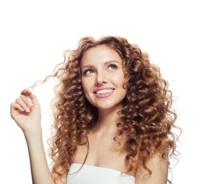 Smiling blonde woman with healthy wavy hair. Looking up isolated on white. Haircare concept royalty free stock photo