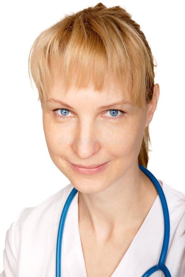 Smiling blue-eyed doctor stock photos