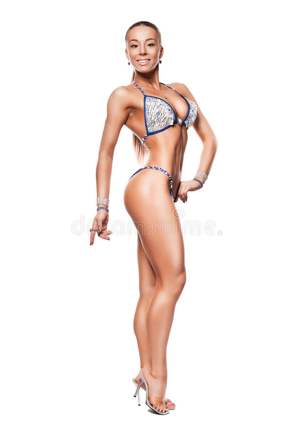 Smiling bodybuilder woman in blue bikini royalty free stock image