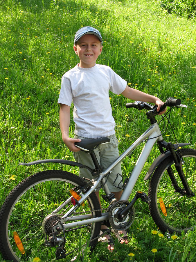 Download Smiling boy on bicycle stock image. Image of land, green - 24650797