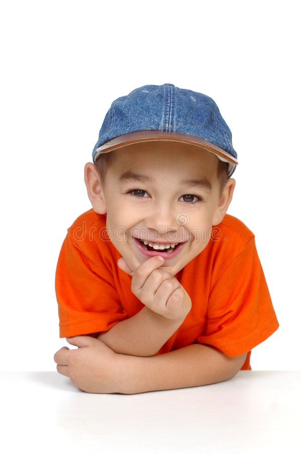 Smiling boy with denim cap stock image